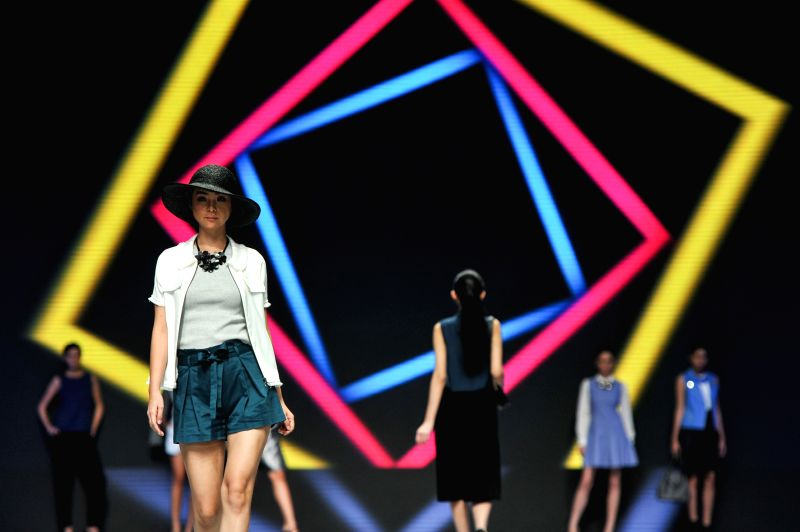 Models present creations on the fashion show by Fashion TV Indonesia during Indonesian Fashion Week 2015 at Convention Center in Jakarta, Indonesia, ...