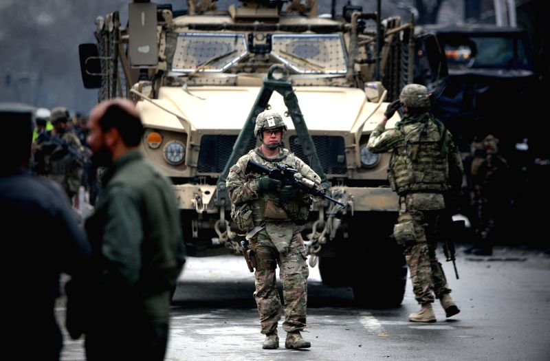 U.S. soldiers guard at the site of a suicide bombing in Kabul, Afghanistan, Feb. 26, 2015. At least two people were killed while several others wounded ...