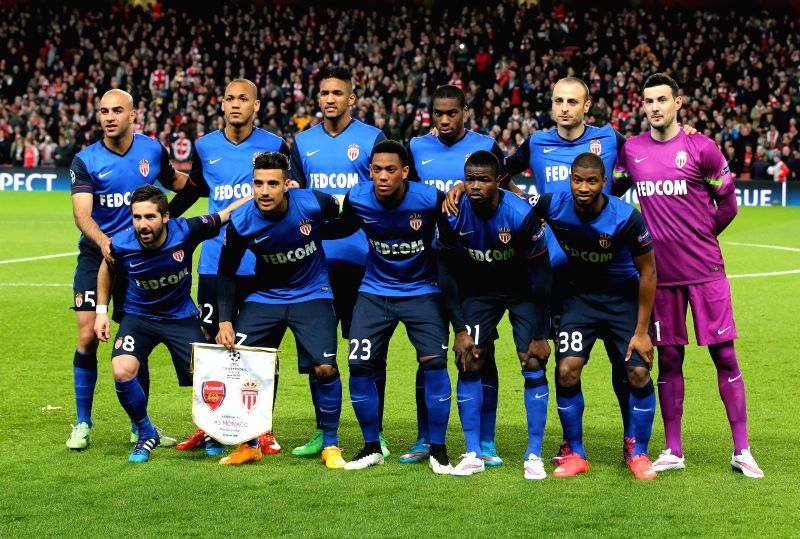 Players of Monaco pose for a group photo prior to the UEFA Champions league Round of 16 first leg match between Arsenal and Monaco at the Emirates ...