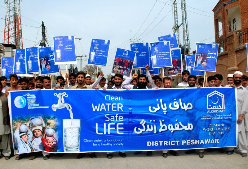 Pakistani civil society members hold placards during a rally ahead of the World Water Day in northwest Pakistan's Peshawar, on March 21, 2015. ...