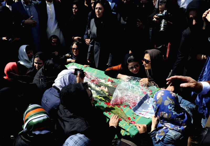 Afghan civil society activists shout slogans to condemn the killing of an Afghan woman Farkhunda during her funeral ceremony in Kabul, Afghanistan, March ...