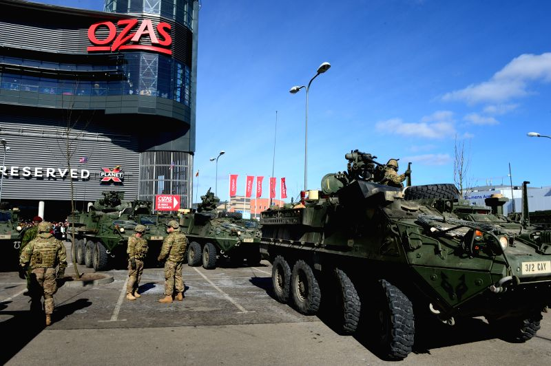 U.S. soldiers stationed in Lithuania display their equipment to local people in Vilnius, Lithuania, on March 22, 2015. Part of the rotating U.S. troops ...