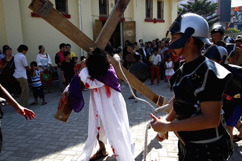 An Indonesian Catholic devotee performs during a passion play on Good Friday to mark Easter in Banda Aceh, Indonesia, April 3, 2015. Passion play is ...