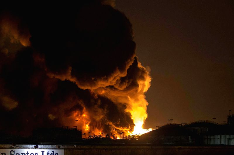 Smoke rise during a fire in a fuel tank storage facility in Santos, Sao Paulo state, Brazil, on April 2, 2015. A big fire affected a tank storage ...