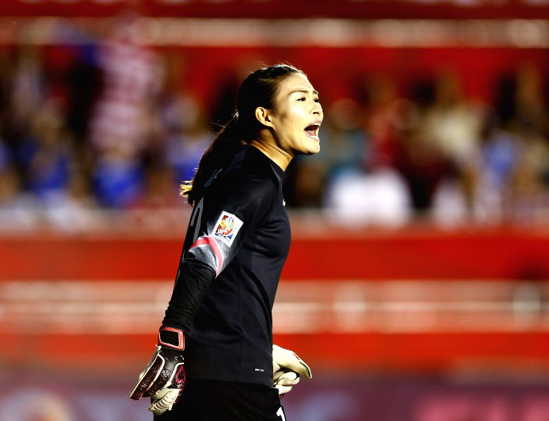 China's goalkeeper Wang Fei shouts to teammates during the quarterfinal between China and the United States at Lansdowne Stadium in Ottawa, Canada on June ...