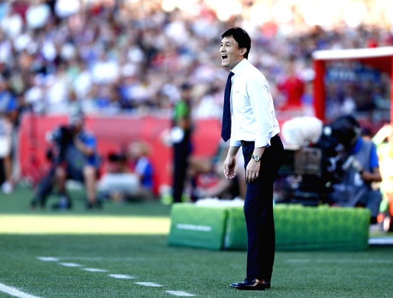 China's head coach Hao Wei reacts during the quarterfinal between China and the United States at Lansdowne Stadium in Ottawa, Canada on June 26, 2015. ...