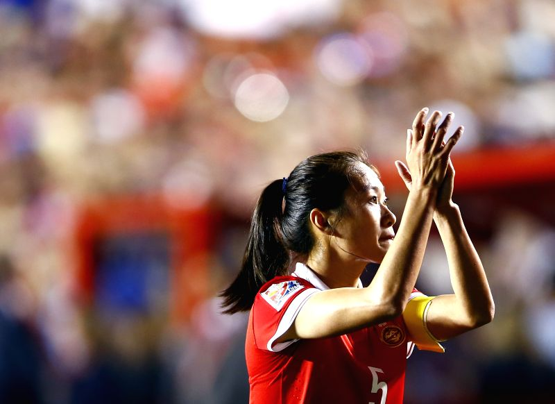 China's Wu Haiyan greets the audience after the quarterfinal between China and the United States at Lansdowne Stadium in Ottawa, Canada on June 26, 2015. ...