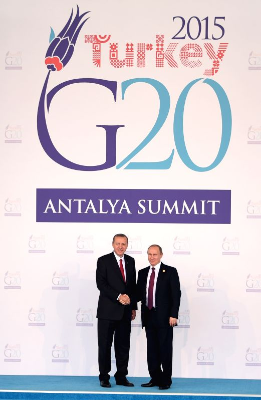 151115) --Turkish President Recep Tayyip Erdogan (L) shakes hands with Russian President Vladimir Putin on the welcoming ceremony of G20 Summit held in Antalya, ...