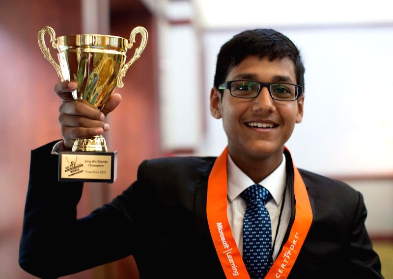 2014 Microsoft Office Specialist World Champion in PowerPoint 2010, Arjit Kansal from India with his trophy in Anaheim, California, United States of America on Aug 4, 2014.