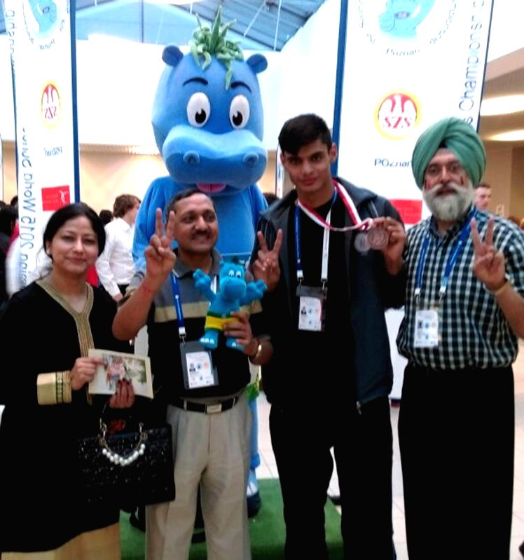 Sahil Chopra, who won bronze medal in 50 meters Freestyle Swimming Competition, World School Games, Poland, with his medal in Patiala on April 23, 2015.