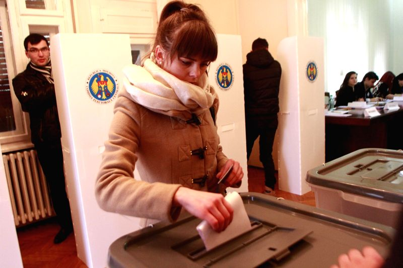 Bucharest (Romania): Moldovan citizens vote at the Moldova' s Embassy in Bucharest, capital of Romania, Nov 30, 2014. Parliamentary elections started in Moldova on Sunday as 20 political ...