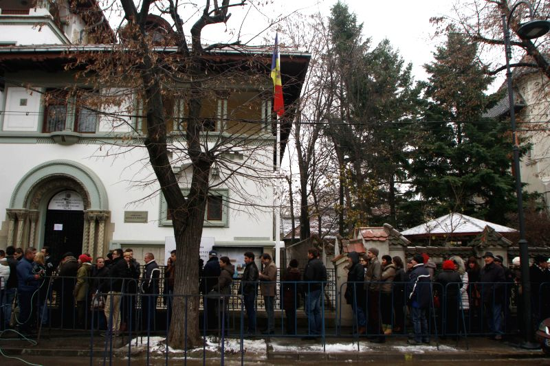 Bucharest (Romania): Moldovan citizens wait in line to vote at the Moldova' s Embassy in Bucharest, capital of Romania, Nov 30, 2014. Parliamentary elections started in Moldova on Sunday as .