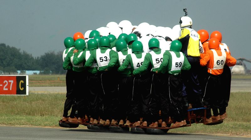 58 men from Army Service Corps (ASC) Motor Cycle Display Team -Tornadoes- in a  to break the world record, board a 500 cc  Royal Enfield motorcycle together and ride for a distance of 1200 ...