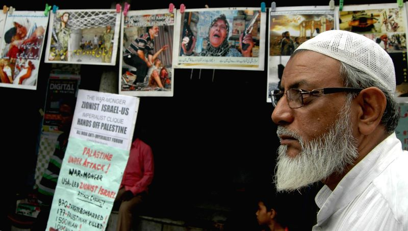 A activist of All India Anti-Imperialist Forum demonstrates against Israeli attacks on Gaza in Kolkata on July 16, 2014.