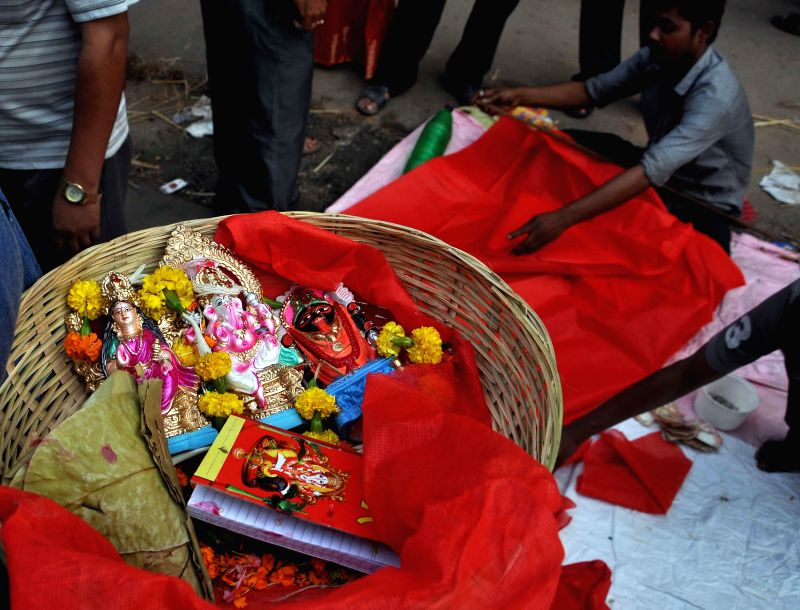 A basket with idols of lord Ganesh and goddess Lakshmi during `Poila Baisakh`  in Kolkata on April 15, 2014.