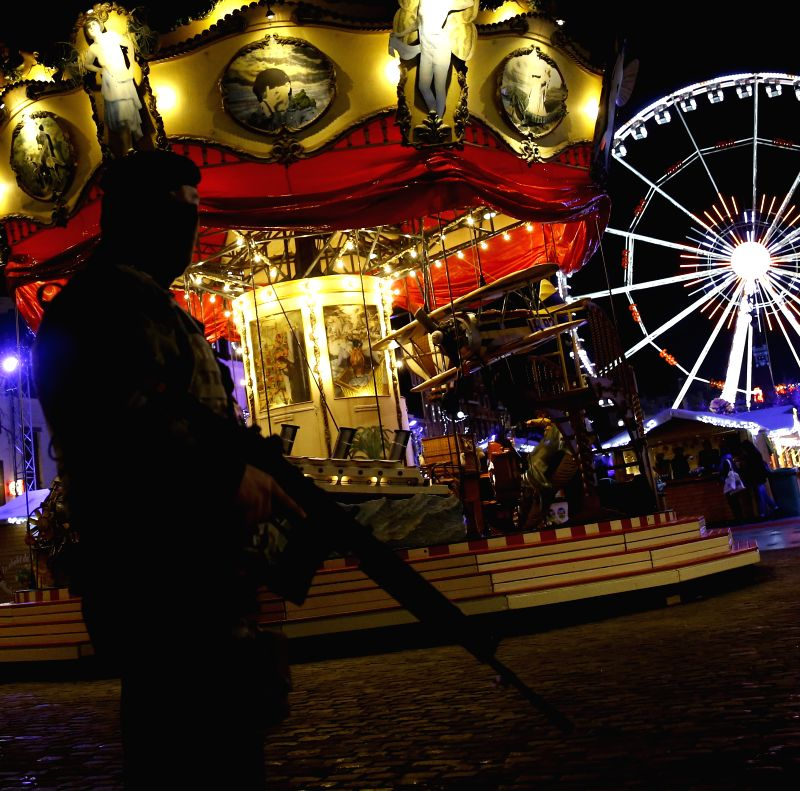 A Belgian soldier patrols at the Christmas market in downtown Brussels, capital of Belgium, Nov. 27, 2015. Brussels' Christmas market opened here on Friday with ...