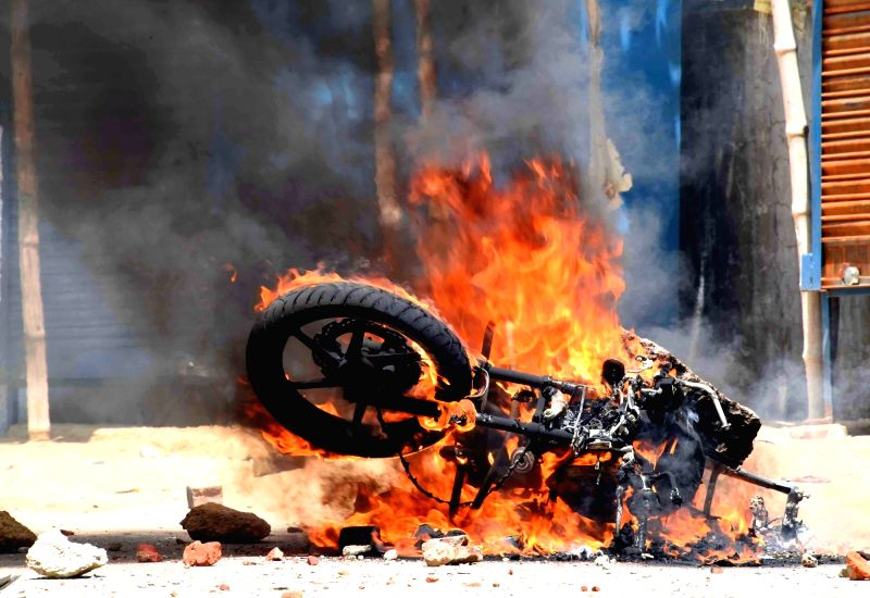 A bike that was torched during an attack on HAM leader Jitan Ram Manjhi's convoy near Dumariah in Bihar on May 26, 2016.