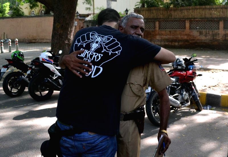"A biker hugs a policeman as  members of `Bikers for Good`, a Motorcycle Community gather at Jantar Mantar to thank Delhi Police for their ""diligence"" in New Delhi on Aug 24, 2014."