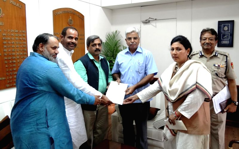 A BJP delegation led by Delhi BJP president Satish Upadhyay including South Delhi BJP MP Ramesh Bidhuri presents a memorandum to Delhi Police Commissioner BS Bassi regarding safety of people from ... - Satish Upadhyay