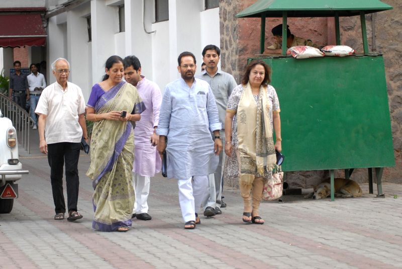 A BJP delegation led by party leader Mukhtar Abas Naqvi comes out after meeting Chief Election Commissioner in New Delhi on April 22, 2014.