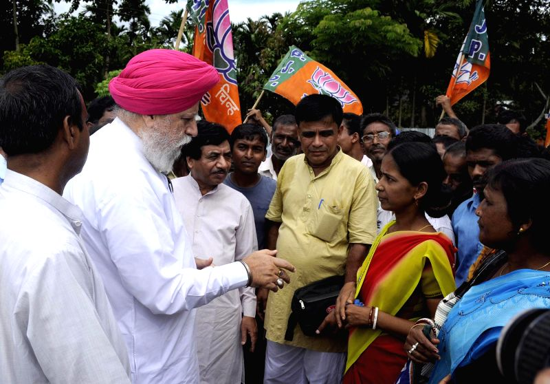 A BJP delegation led by party leader SS Ahluwalia interacts with villagers at Jatrapur village of Tripura on July 28, 2014. Post poll violence was reported in the village.