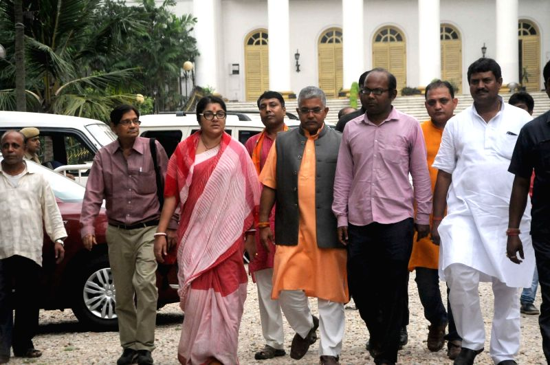 A BJP delegation led by West Bengal BJP chief Dilip Ghosh comes out of Raj Bhawan after meeting Governor K N Tripathi, in Kolkata, on Aug 2, 2018. - Dilip Ghosh and K N Tripathi