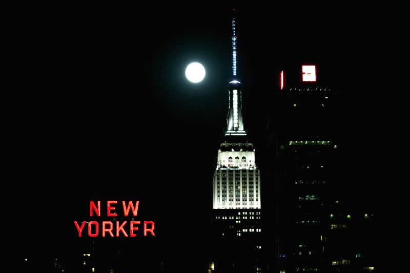 A blue moon is seen over New York, the United States, on July 31, 2015. The blue moon is the second appearance of a full moon in the same calendar month. (Xinhua/Li ...