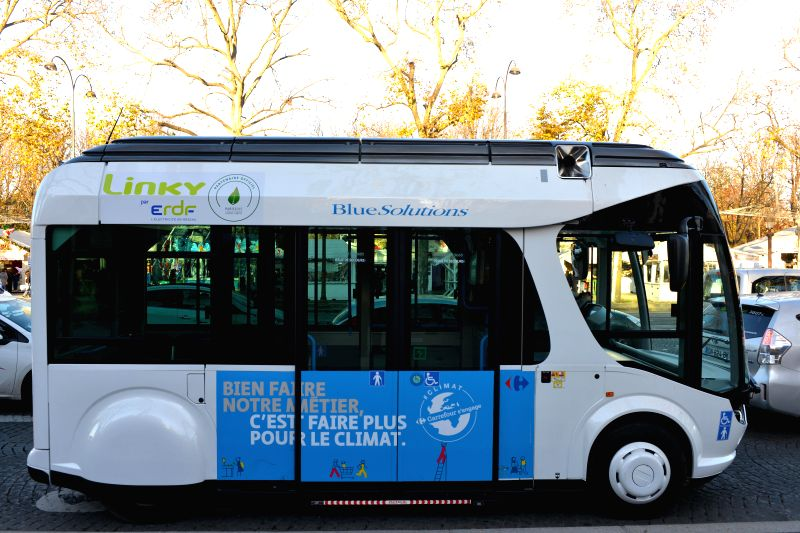 "A ""Bluetram"" bus is seen on Les Champs-Elysees avenue in Paris, France, Dec. 4, 2015. A number of devices showcasing the usage of clean energy sources are ..."