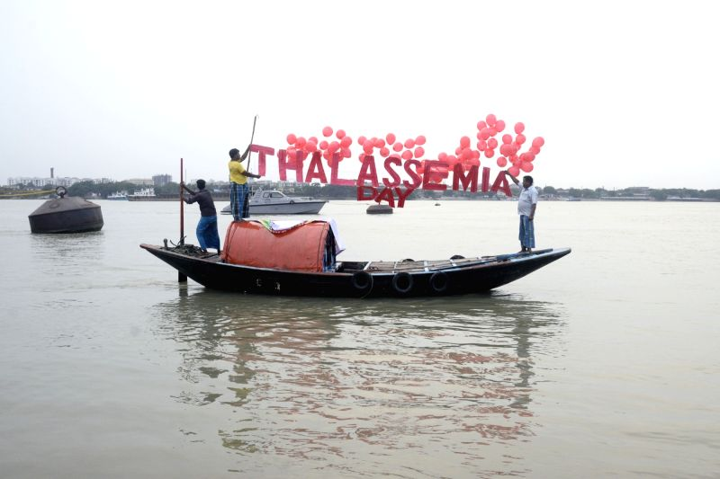 A boat decorated with balloons to spread awareness on World Thalassemia Day  in Kolkata on May 8, 2017.
