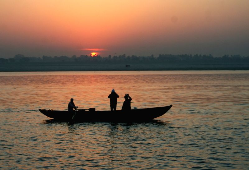 A boat sails during the sunrise on the Gange river in Varanasi on Nov 30, 2015.