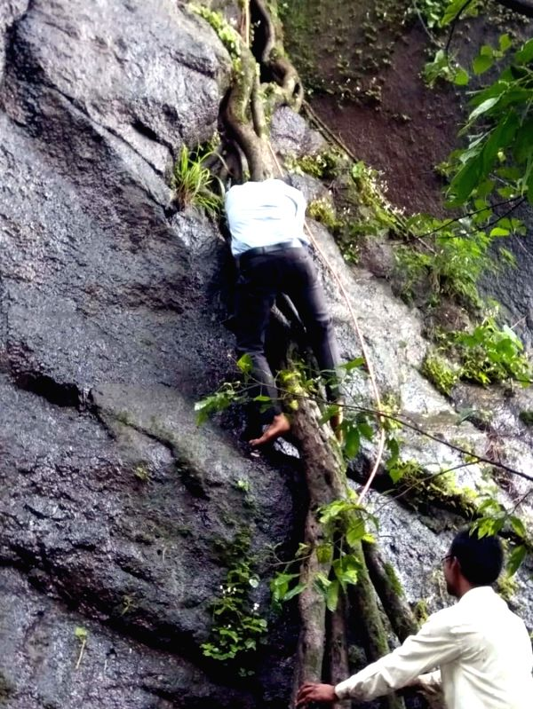 A body of one of those killed when a private bus on a picnic trip plunged into a deep ravine near Poladpur in Maharashtra's Raigad on July 28, 2018. At least 32 university staffers were ...