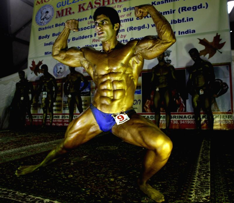 A bodybuilder during a bodybuilding competition in Srinagar on June 18, 2014.