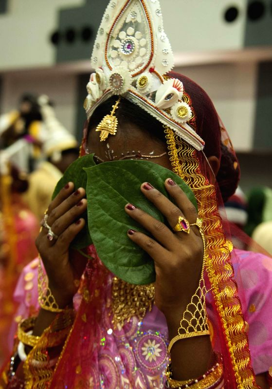 A bride during a mass marriage programme organised by Vishwa Jagriti Mission Trust in Kolkata on June 18, 2014.