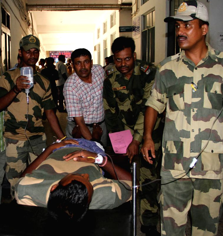 A BSF jawan injured in cross border firing at R S Pura Sector of Jammu and Kashmir being taken for treatment at a Jammu hospital on Aug 4, 2015.