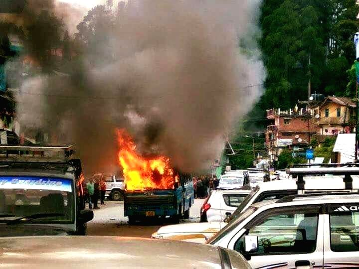 A bus that was torched by Gorkha Janmukti Morcha (GJM) activists during a demonstration in Darjeeling on June 8, 2017.