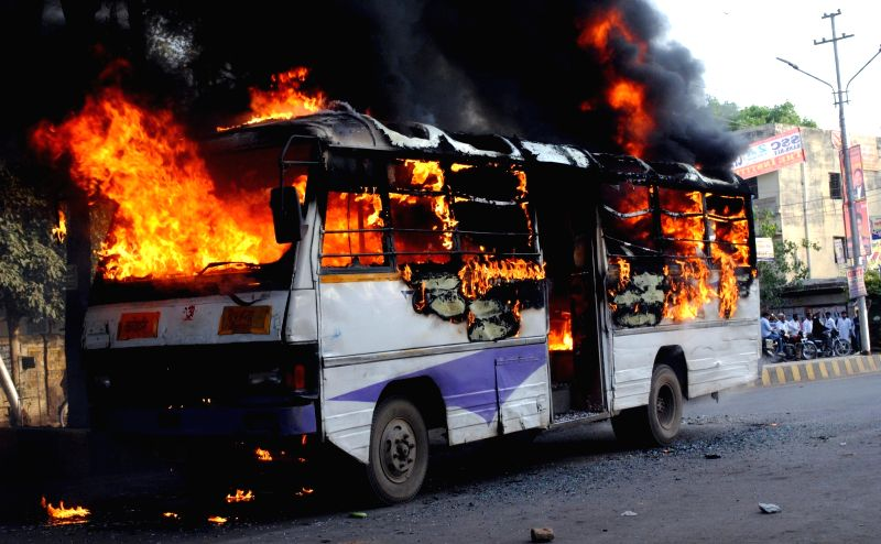 A bus torched during a clash between students of Allahabad University and police over arrest of student leaders in Allahabad on April 28, 2017.