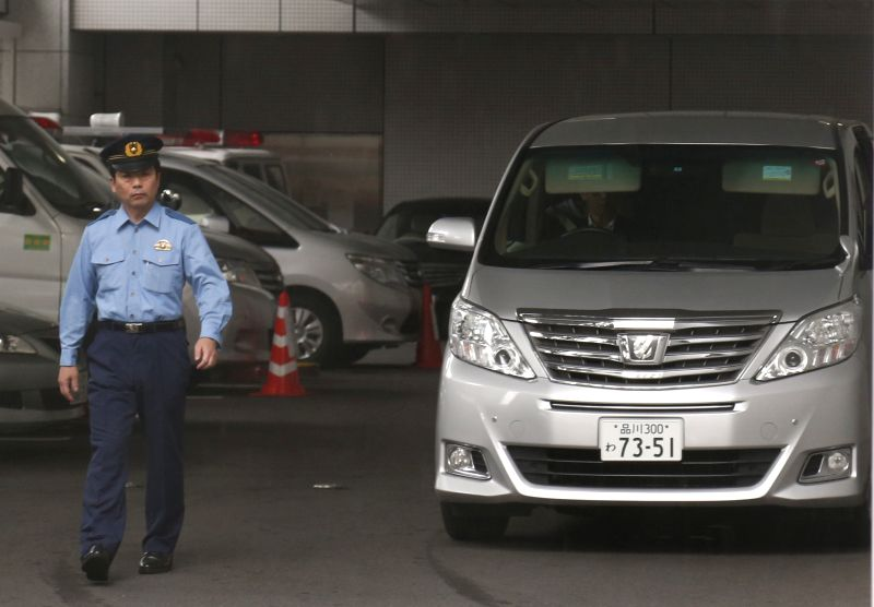 A car carrying Toyota Motor Corp.'s former executive Julie Hamp leaves the Harajuku Police Station in Tokyo, Japan, July 8, 2015. Hamp, who resigned as a Toyota ...