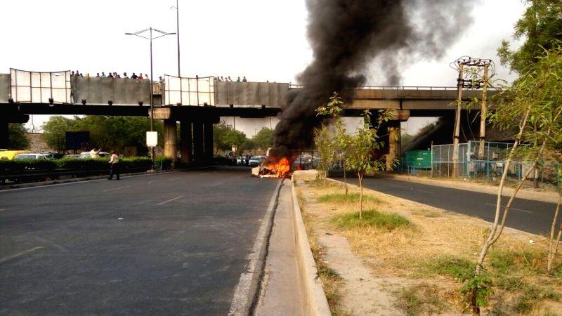A car catches fire on Delhi-Noida-Delhi Flyway on May 2, 2017.