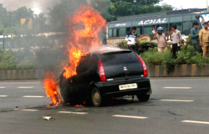 A car catches fire on Western Express Highway, Santacruz in Mumbai on Aug 21, 2014.