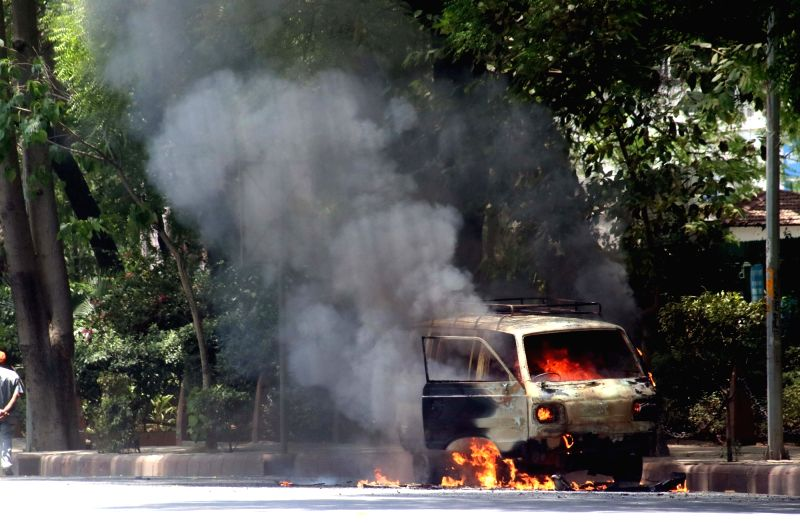 A car caught fire near Parliament police station in New Delhi on May 14, 2016.