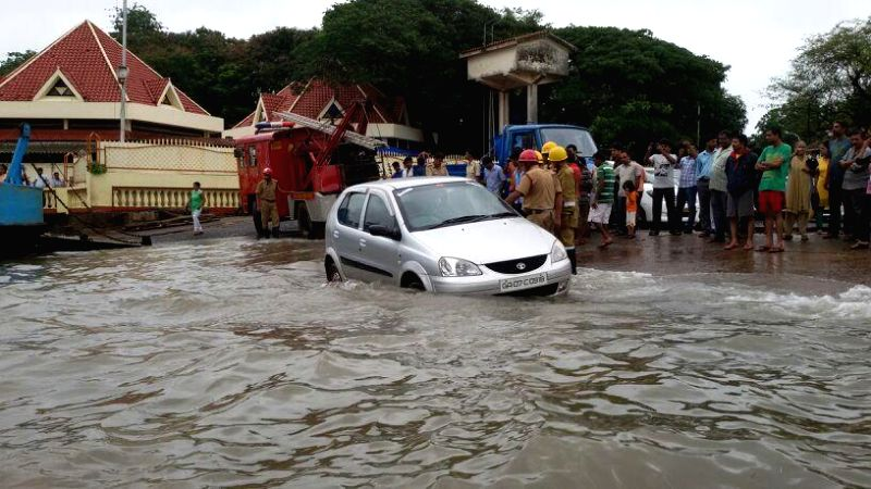 A car gets stuck as sea water gets accumulated on the road during high tide in Panaji on June 18, 2014.