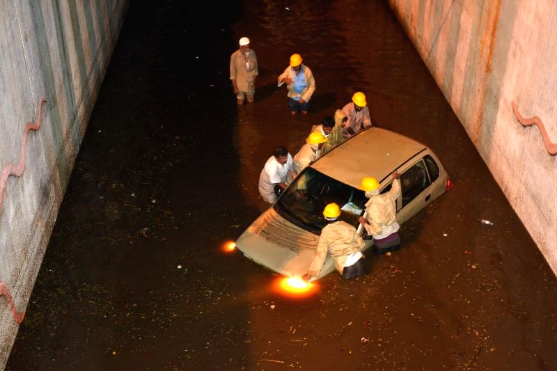 A car gets stuck in waterlogged underpass after heavy rains in Bengaluru, on May 25, 2017.