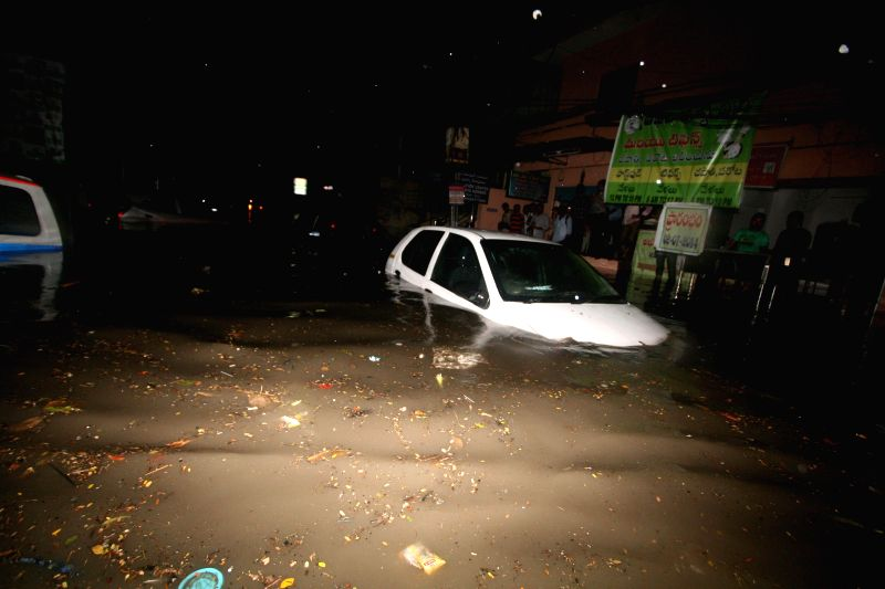 A car gets submerged on a waterlogged street of Hyderabad after heavy rains in the city on July 7, 2014.