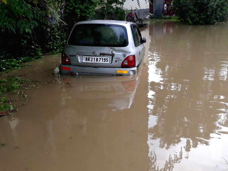 A car partially submerged in the flood hit Nalanda district of Bihar on Aug 8, 2018.