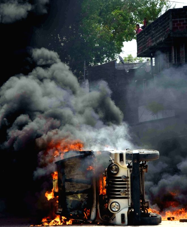 A car that was torched during an attack on HAM leader Jitan Ram Manjhi's convoy near Dumariah in Bihar on May 26, 2016.