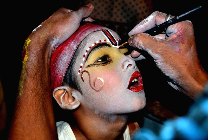 A child artist prepares to perform during the Raas Lila Mahotsov- a popular form of folk theatre, in Majuli  of Assam's Jorhat district on Nov 28, 2015.