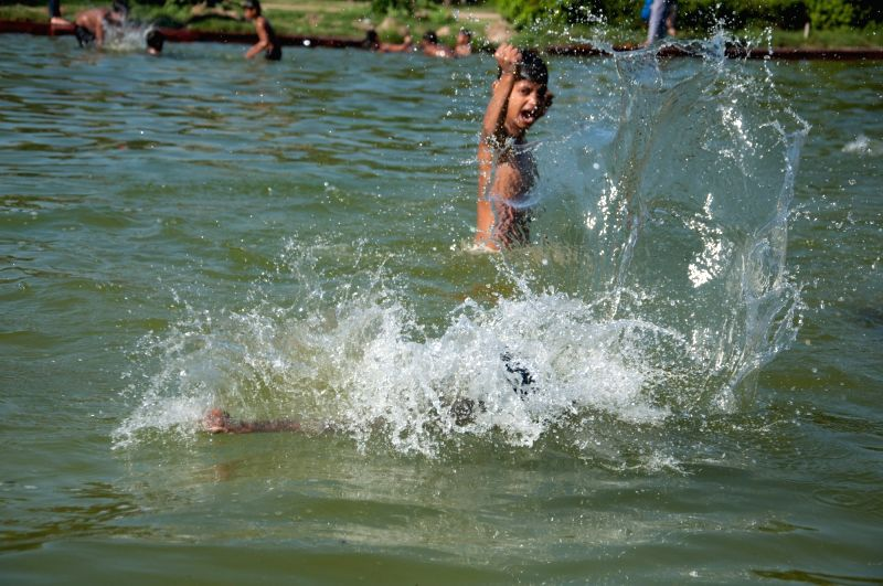 A child beats the heat on a hot day. (File Photo: IANS)