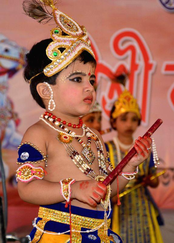 A child disguised as lord Krishna during a Janmashtami programme organised by Vishwa Hindu Parishad in Guwahati on Aug 17, 2014.