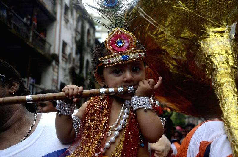 A child disguised as lord Krishna during a Janmashtami programme in Mumbai on Aug 18, 2014.