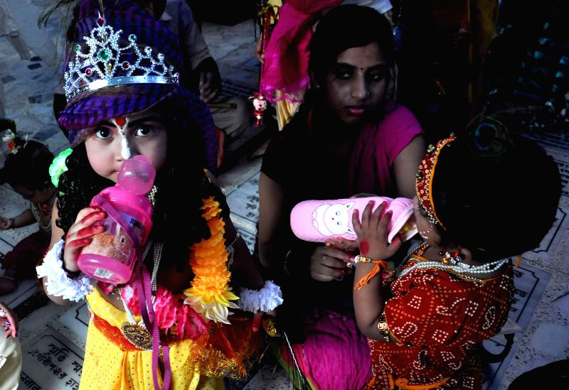 A child disguised as lord Krishna on Janmashtami in Kolkata on Aug 17, 2014.